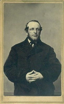 Old photograph of George Douglass with beard and wearing a dark coat