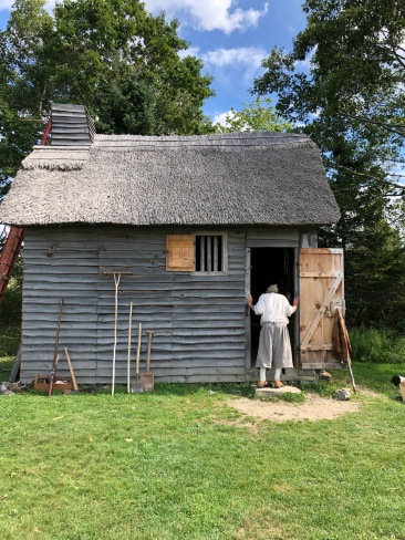 The recreated fisherman's hut with one of the reenactors